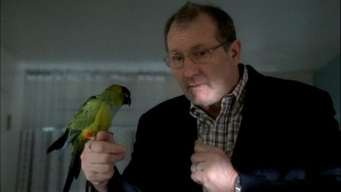 Bill holds his bird Zippy on his finger