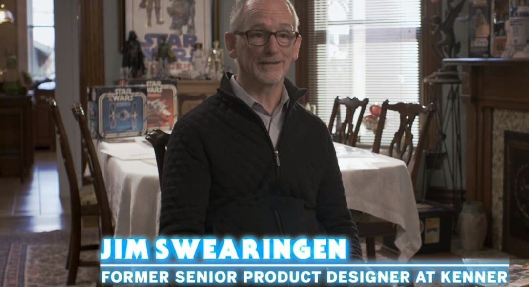 Talking head shot of Jim Swearingen (chyron reads Former Senior Product Designer at Kenner) sitting in his dinig room