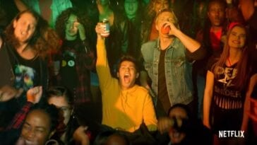 A crowd at a concert, many of whom are drinking, in Cobra Kai Season 3