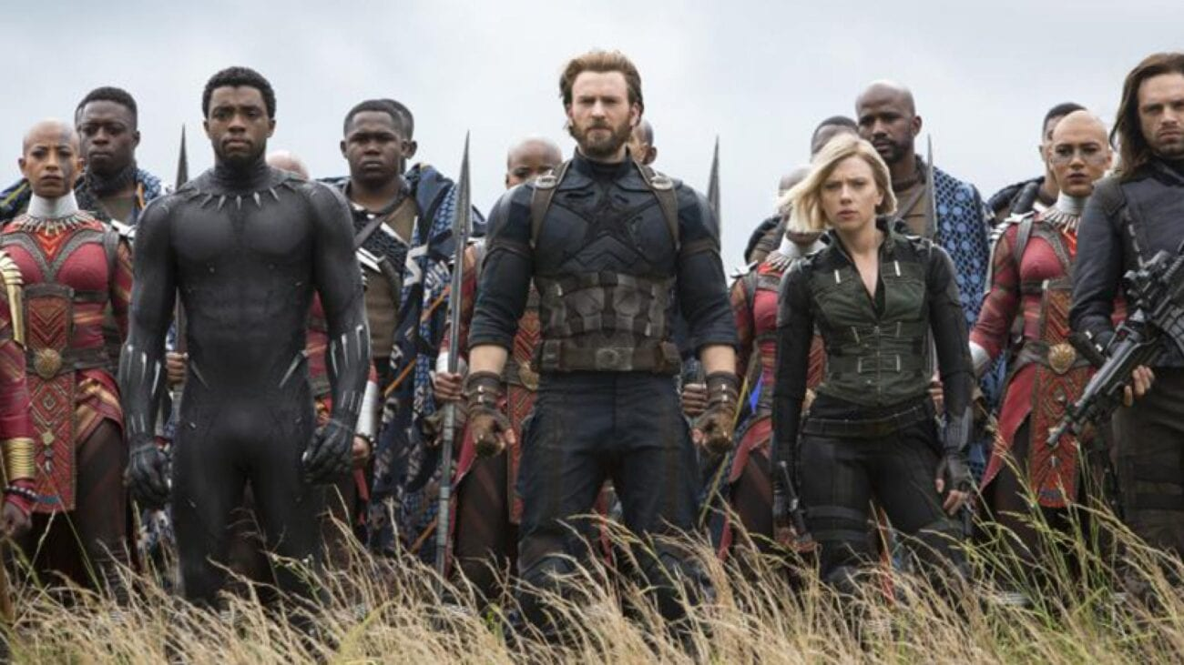 Black Panther, Captain America, Black Widow, Winter Soldier and others stand in a field