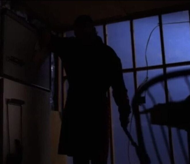 Leo, looming as an intimidating silhouette in his dark house.