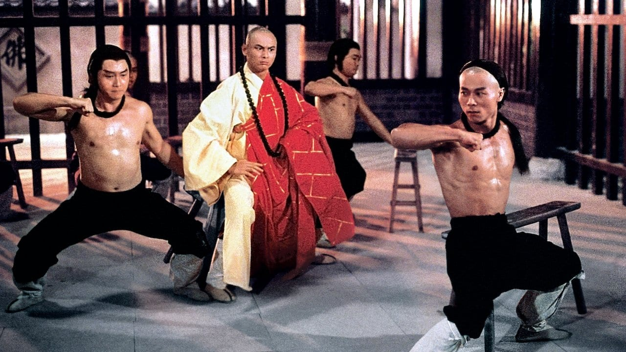 A shot from Disciples of the 36th Chamber that shows Gorden Liu training three disciples in the Shaolin way.