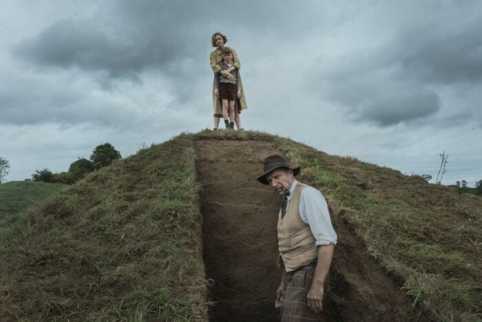Mrs. Pretty and her son Robert observe Basil from above the mound dig.
