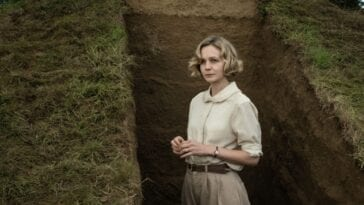 Mrs. Pretty stands within the partially excavated mound.