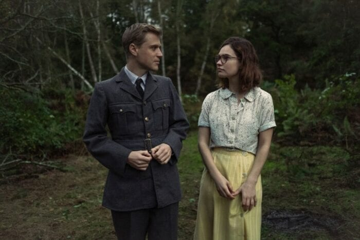 Rory and Peggy stroll in a forest
