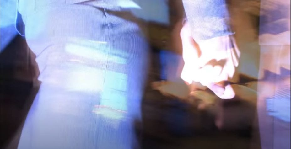 Hands held against blurry light in David Lynch's Lady Blue Shanghai