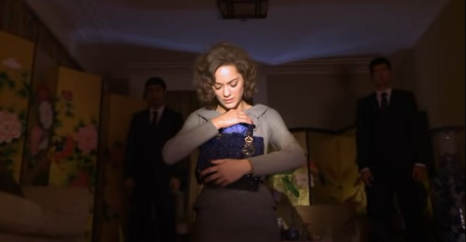 Marion Cotillard cradles a blue purse in David Lynch's Lady Blue Shanghai