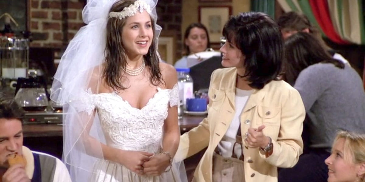 Rachel in a wedding dress beside Monica, with Chandler on lower left and Phoebe on lower right in the Friends pilot episode