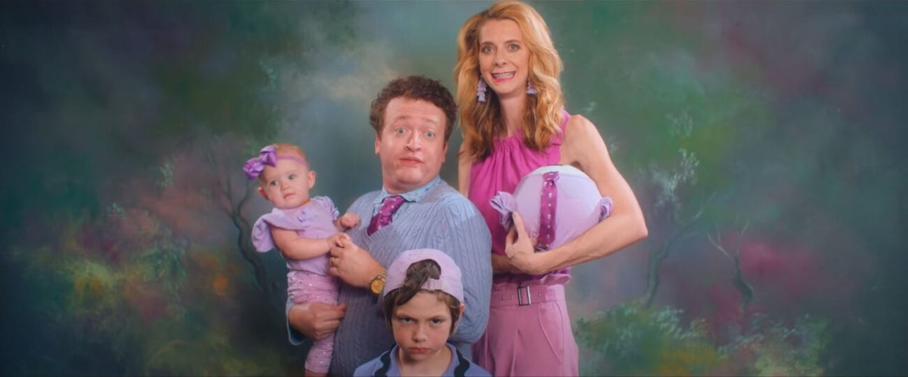 Lisa's family, the Wetbottoms, pose for a family picture. Dennis awkwardly holds the baby, Lisa holds the baby soccer ball, and Bob scowls into the camera.