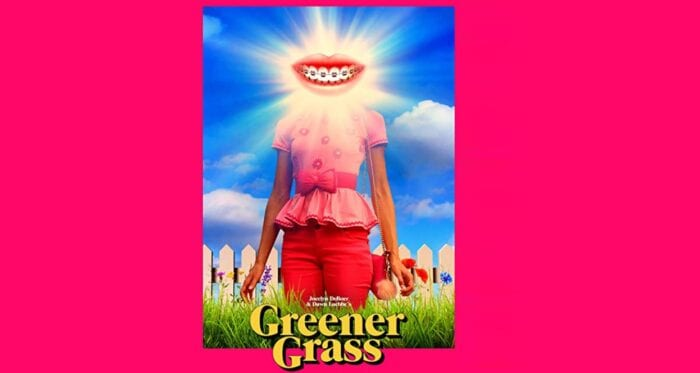 Greener Grass Poster. A woman in all pink (presumably Jill) stands in front of a picket fence in thigh-height grass. Her face is obscured by a giant gleaming smiling mouth.