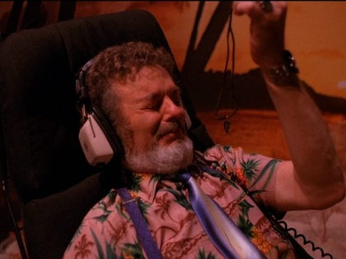 Dr. Jacoby listening to Laura Palmer on tape.