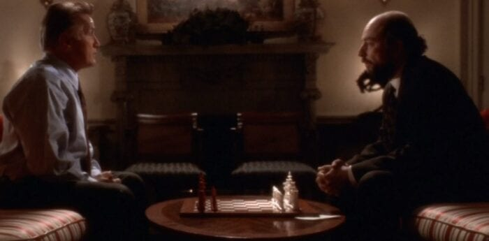 President Bartlet (Martin Sheen) and Toby (Richard Schiff) sitting in the Oval Office on couches with a chess set between them