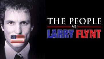 Larry Flynt stares straight ahead with an American Flag sticker taped over his mouth