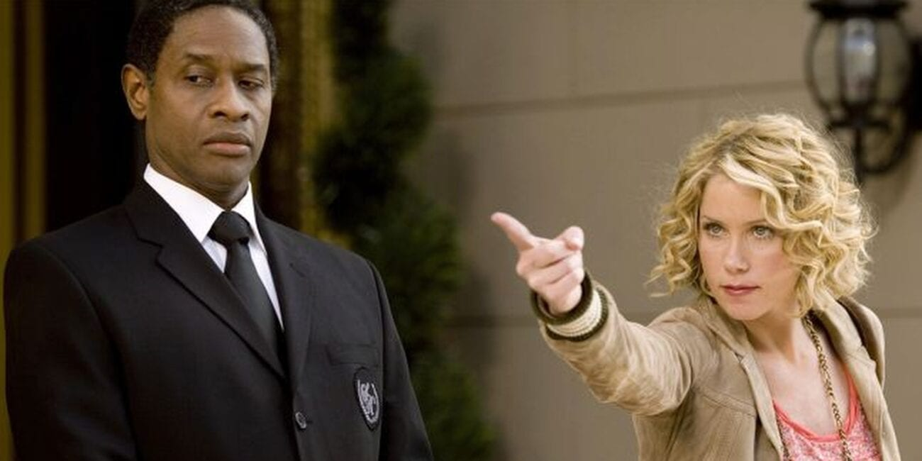Samantha pointing, with her doorman standing next to her in Samantha Who a 2000s TV show