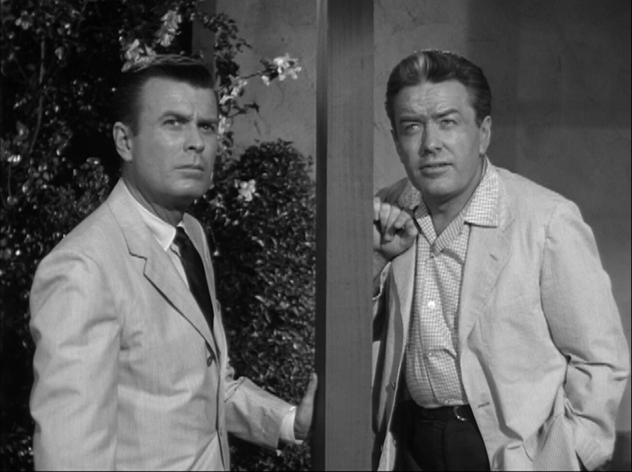 "Bill and Roger stand looking off towards the sky in Alfred Hitchcock Presents ""Special Delivery"""