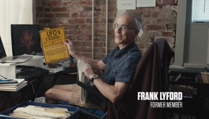 Frank Lyford sits in his home office