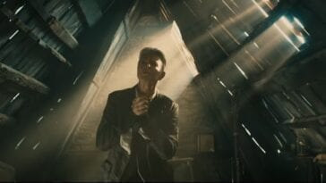 "David Bowie in a dusty, triangular attic from the video for ""Blackstar"""