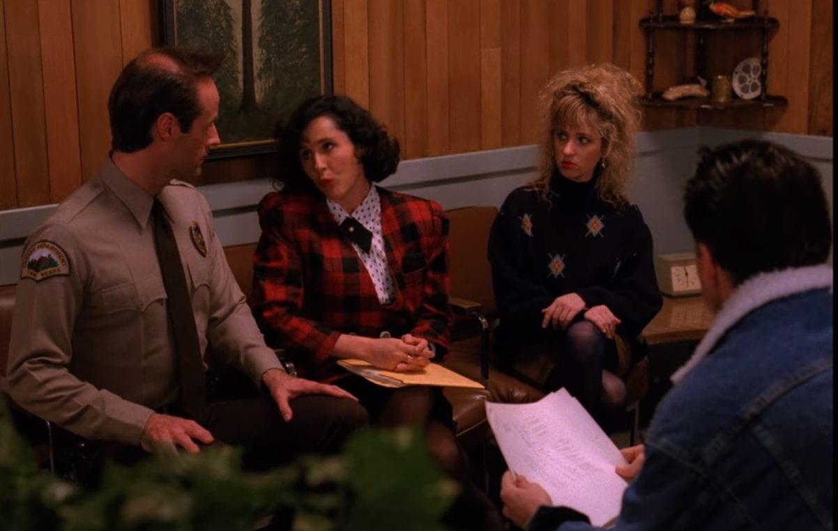 Andy, Lucy, and Dick sit with social worker Judy Swain