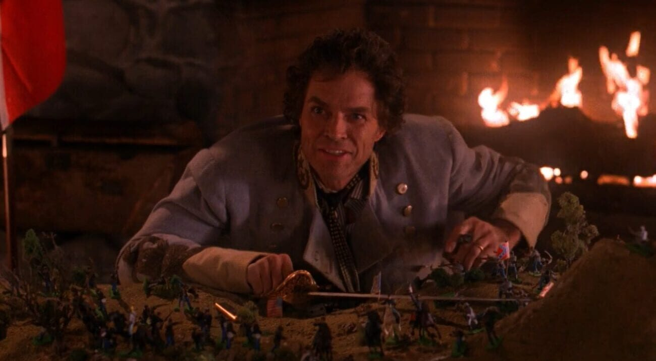 Ben Horne is confident and happy about his civil war figurines battle, and a fireplaces crackles behind him.