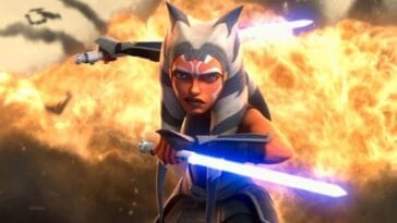 Ahsoka wields two light sabers in front of an explosion in Star Wars: The Clone Wars