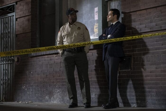 Deputy Deacon and Detective Baxter discuss the case behind caution tape.