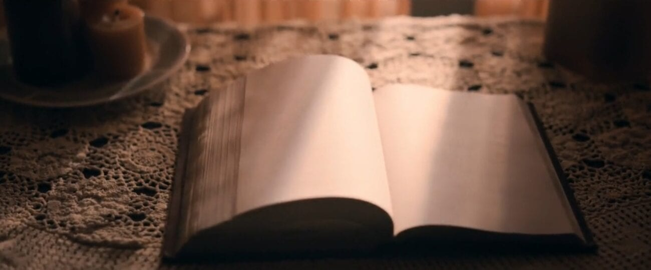 The Stand S1E3 - A book of blank pages is opened up on a nice table in front of a curtained window