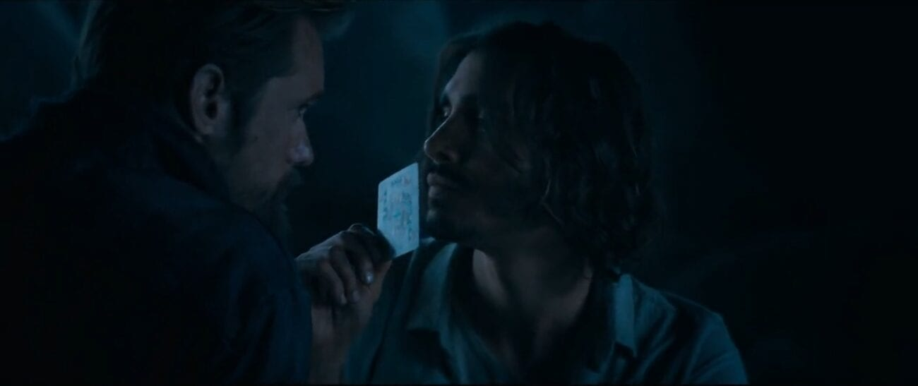 The Stand S1E3 - Nick holds up a playing card to Flagg who is facing him