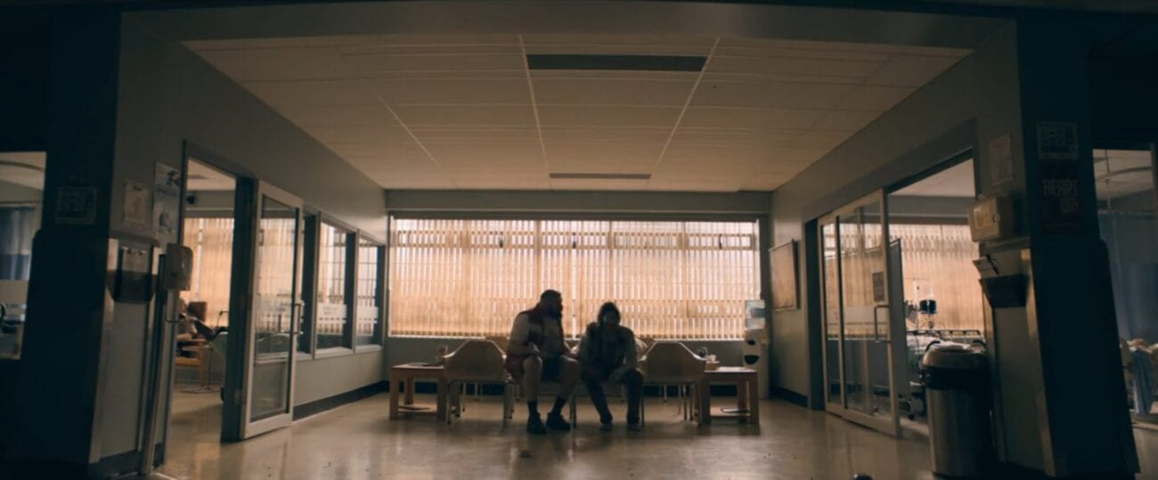 The Stand S1E3 - Tom and Nick sit in a set of hospital waiting room chairs at dusk