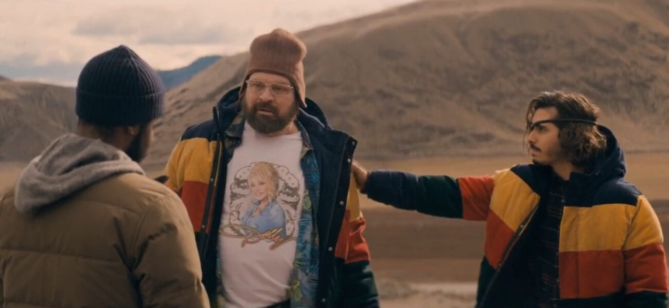 Larry faces Tom and Nick, wearing matching jackets, standing outside in the mountains in The Stand Episode 4