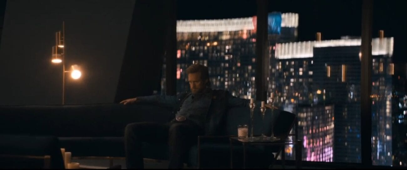 The Stand S1E5 - Flagg kicks back on a large sofa with the lights of Vegas in the backdrop