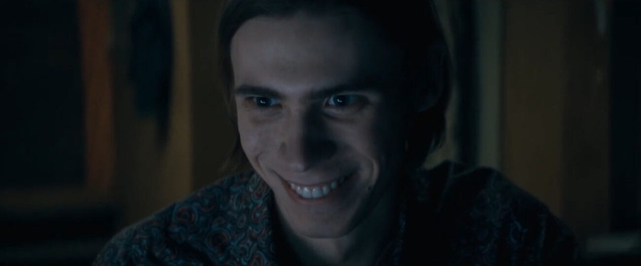 Harold in the glow of a computer screen smiling wickedly in The Stand Episode 5