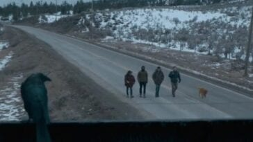 The four plus Kojak walk down a snowy road, a crow perched above keeping watch in The Stand Episode 7