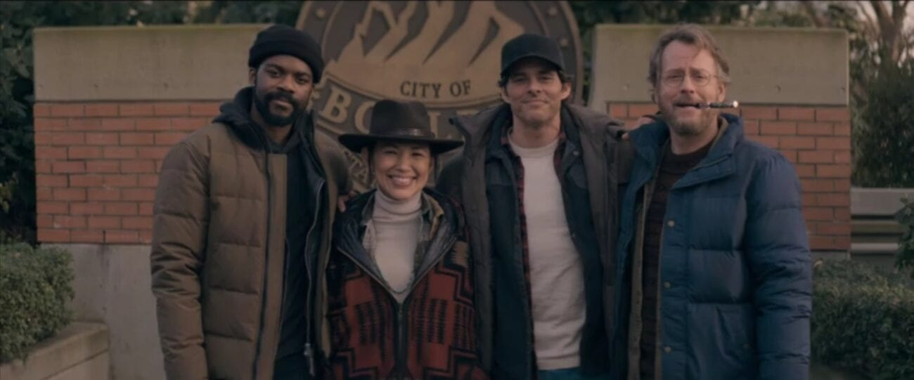 Larry, Ray, Stu and Glen pose for a picture in front of the City of Boulder seal in The Stand Episode 7