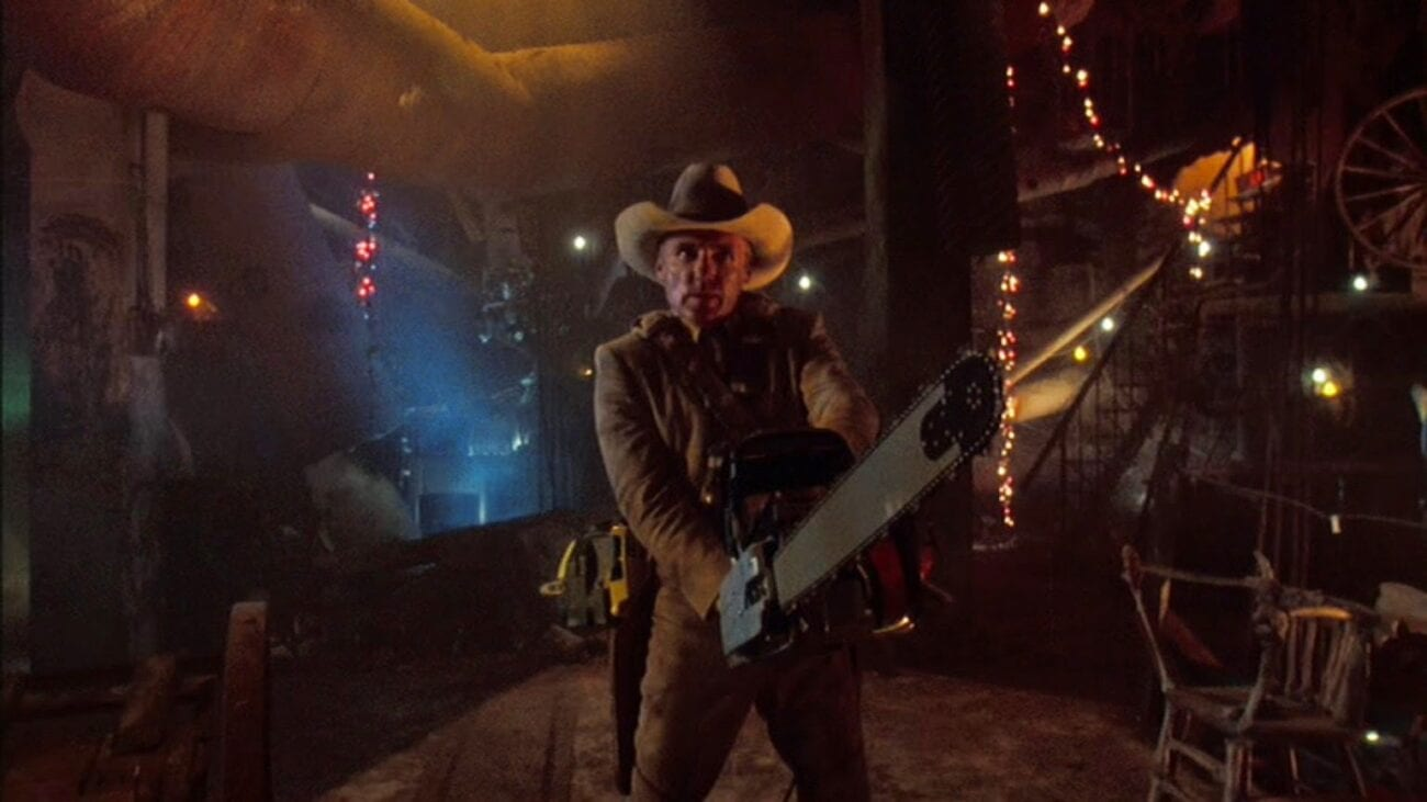 Lefty (Dennis Hopper) brandishes a chainsaw of his own as he assaults the cannibal Sawyer family's lair