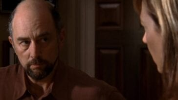 Close up of Toby Ziegler (Richard Schiff) looking at C.J. Cregg (Allison Janney)