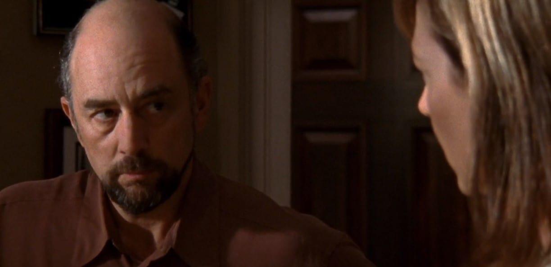 Close up of Toby Ziegler (Richard Schiff) looking at C.J. Cregg (Allison Janney)