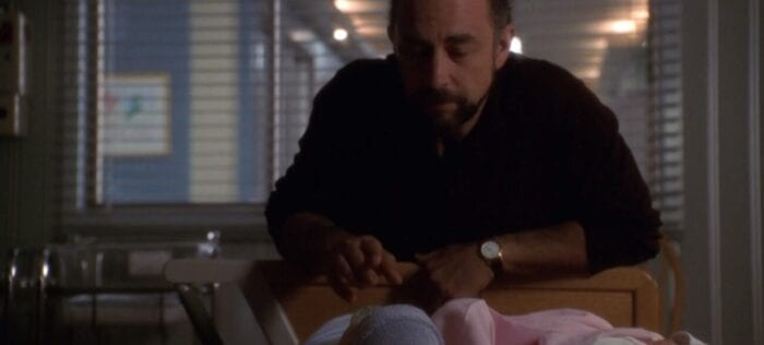 Toby Ziegler (Richard Schiff) in the hospital nursery looking at his babies, Huck and Molly