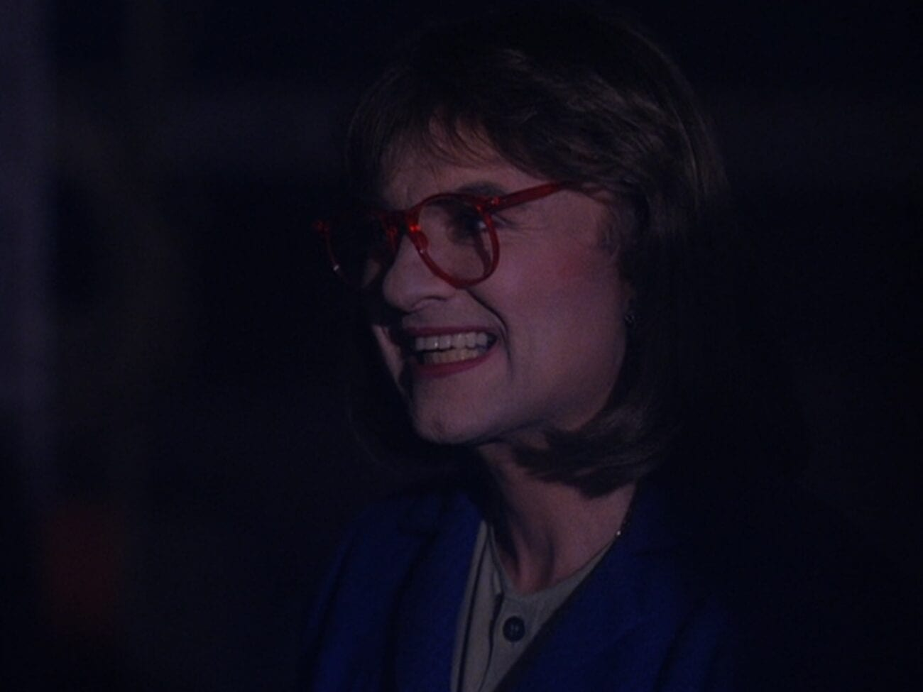 Windom Earle dressed as the Log Lady with a creepy grin on his face
