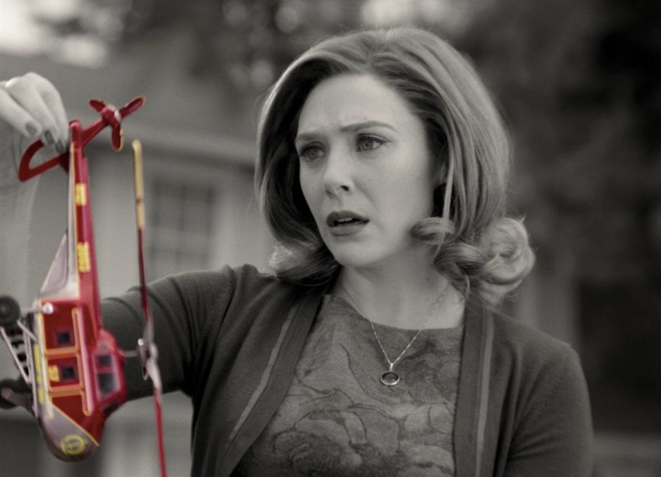 Wanda Maximoff (Elizabeth Olsen) holds a colorful helicopter toy in Marvel and Disney+'s WandaVision