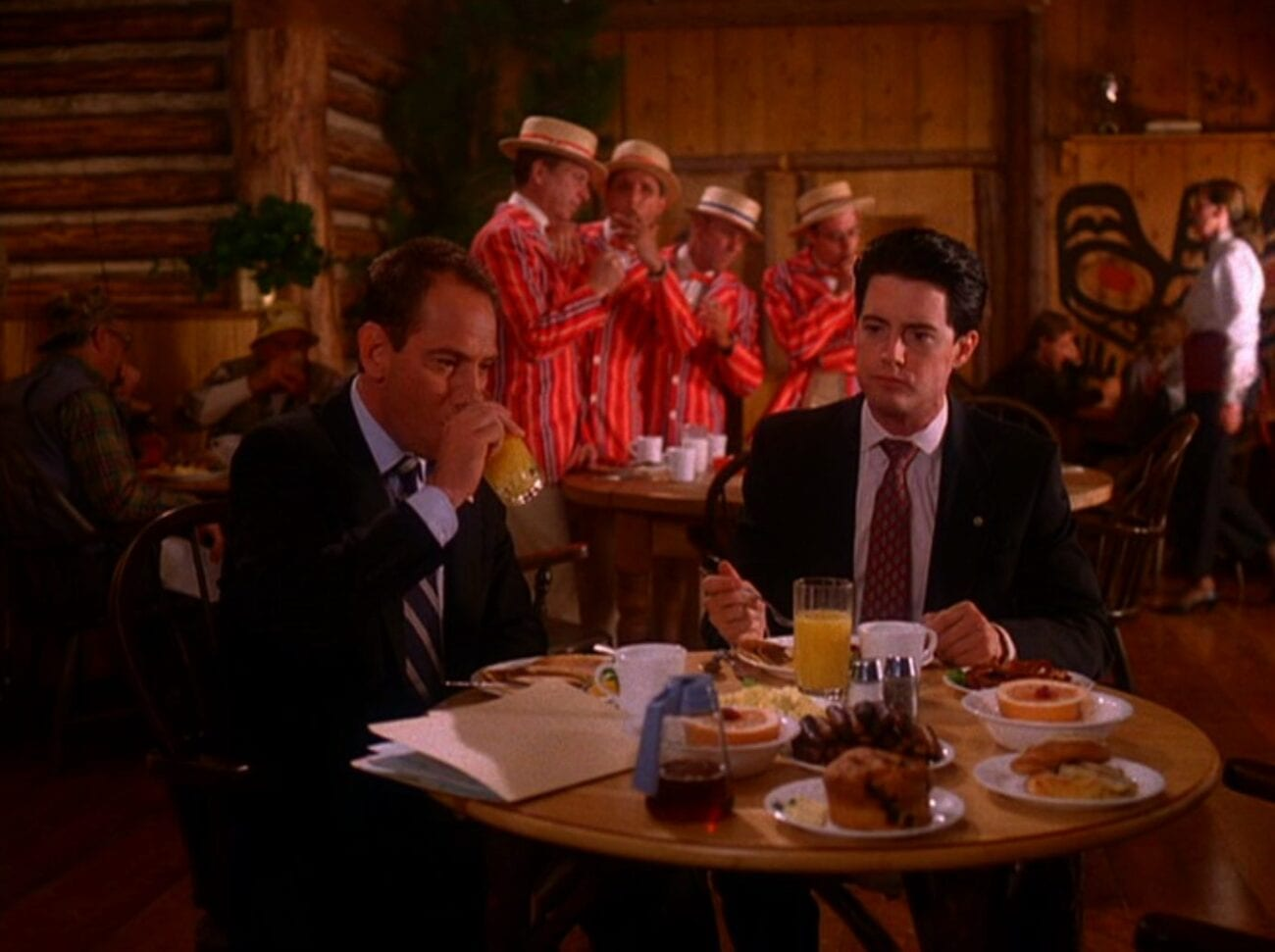 Albert and Cooper have breakfast while a barbershop quartet sing