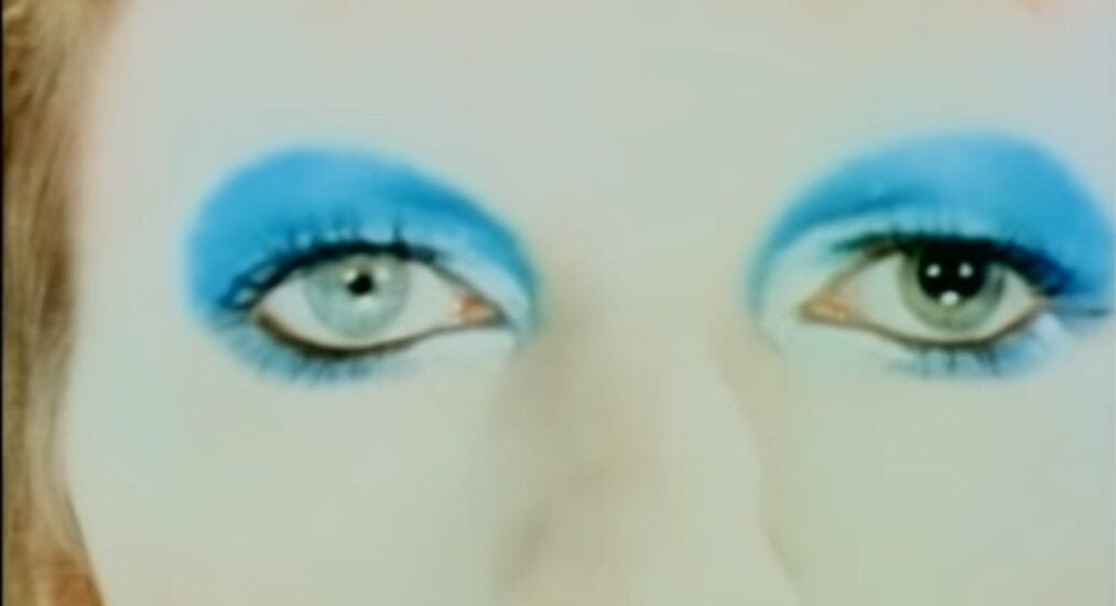 The blue-shadowed eyes of David Bowie in his glam period