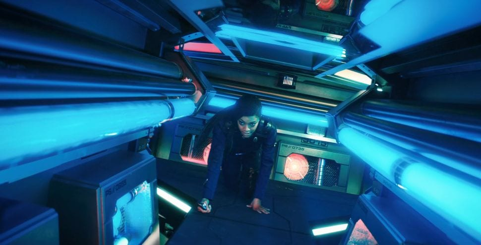 "Burnham (Sonequa Martin-Green) crawls through a blue lit Jeffries tube in Star Trek Discovery S3E12 ""There is a Tide..."""