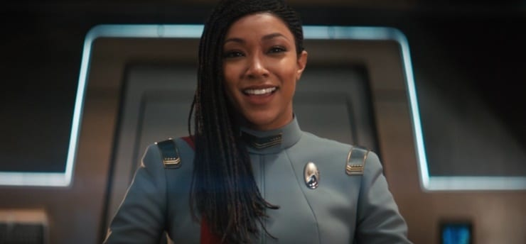 Captain Michael Burnham (Sonequa Martin-Green) in the gorgeous new grey uniform with command red stripe in the captain's chair