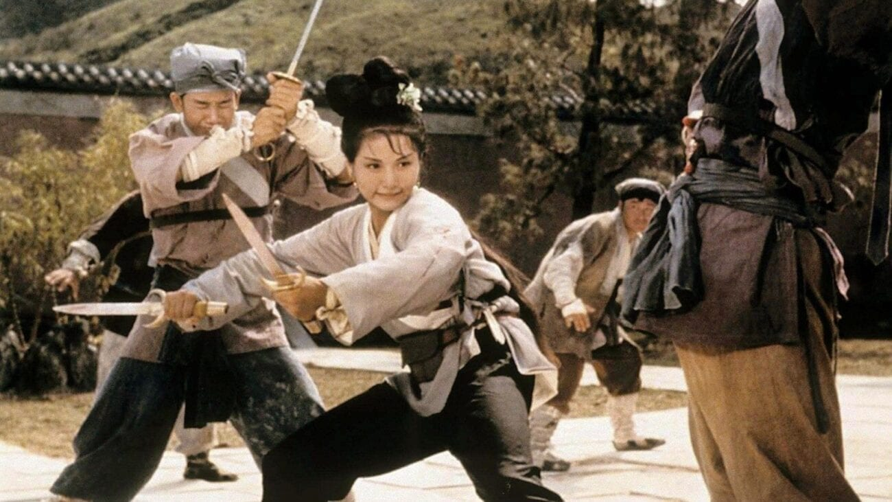 Cheng Pei-pei as Golden Swallow stands with sword drawn, fighting off assassins from all sides in the Shaw Brothers Classic, Come Dine With Me.