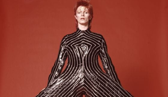 david bowie wearing a bodysuit with massive trousers
