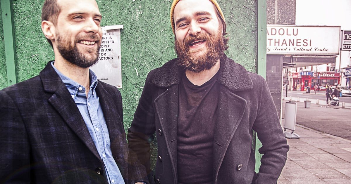 Frauds band 2 men smiling
