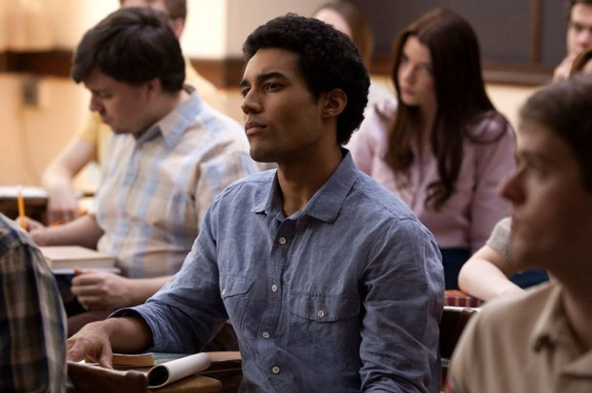 Barry listens intently from his desk in class.