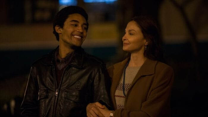 Barry talks to Ann on a street at night.