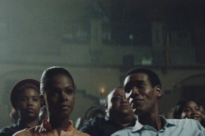 Barack looks over at Michelle during a movie in a theater.