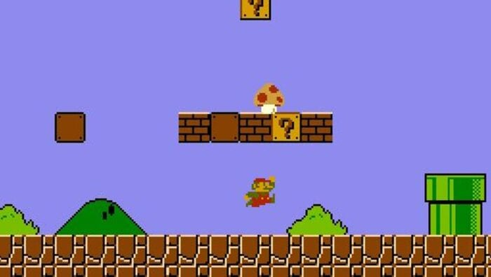 Mario jumps under a block, producing a power up mushroom